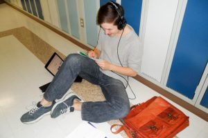 Student Working in the hallway