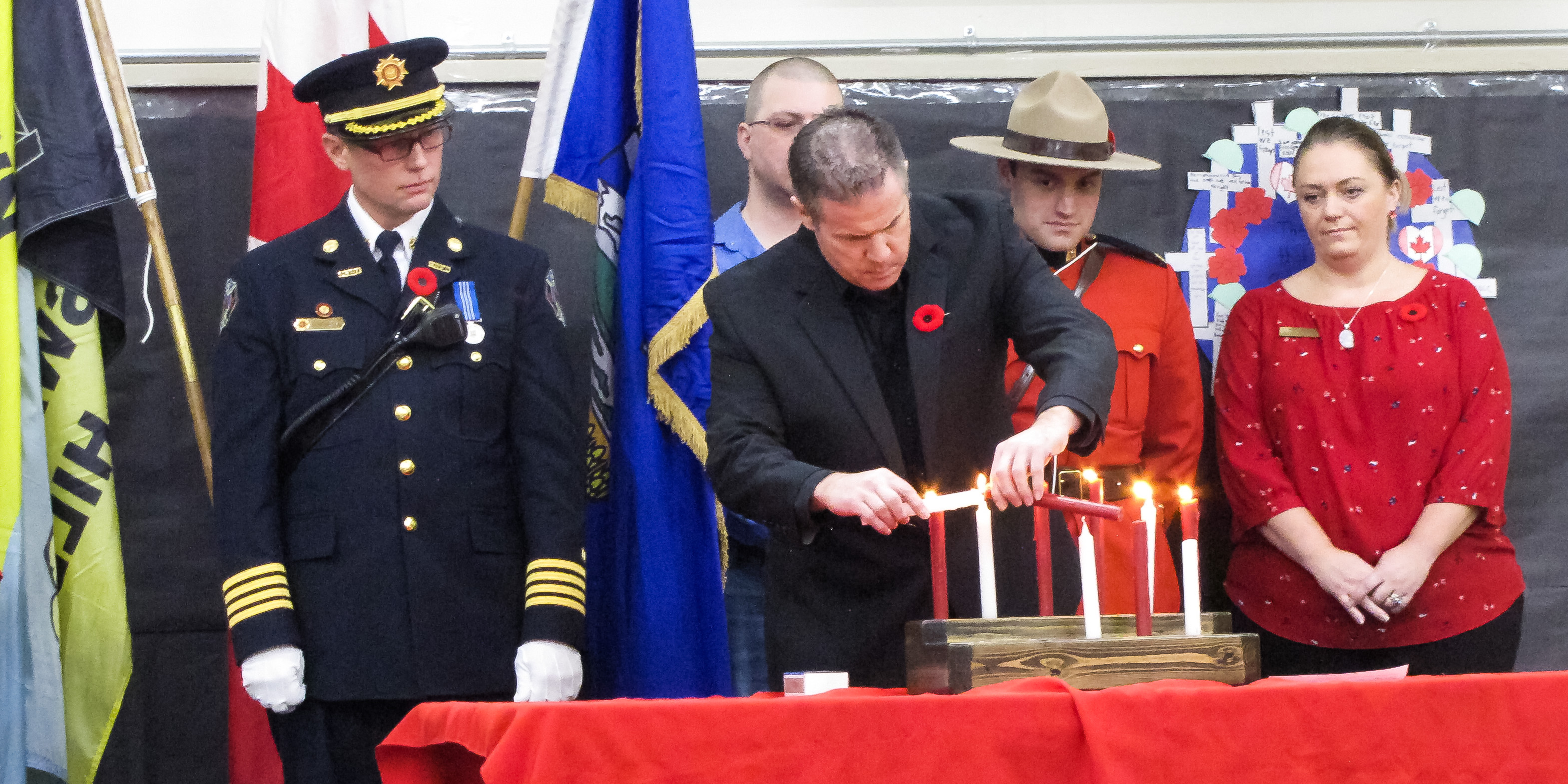 Mr. Sekulich & Visiting Dignitaries Light the Remembrance Day Candles. Slideshow in Galleries