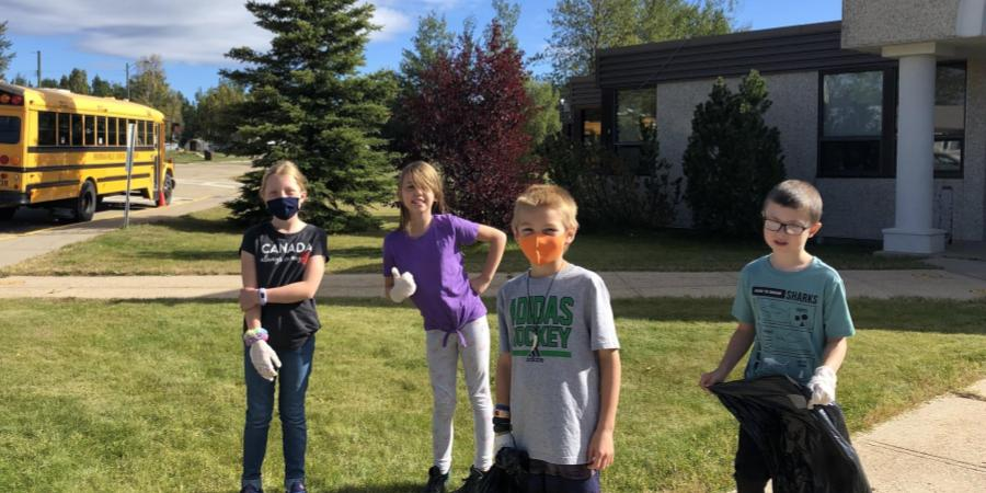 Some Grade 4 students choose to continue to wear their masks while out in the fresh air practicing school citizenship.