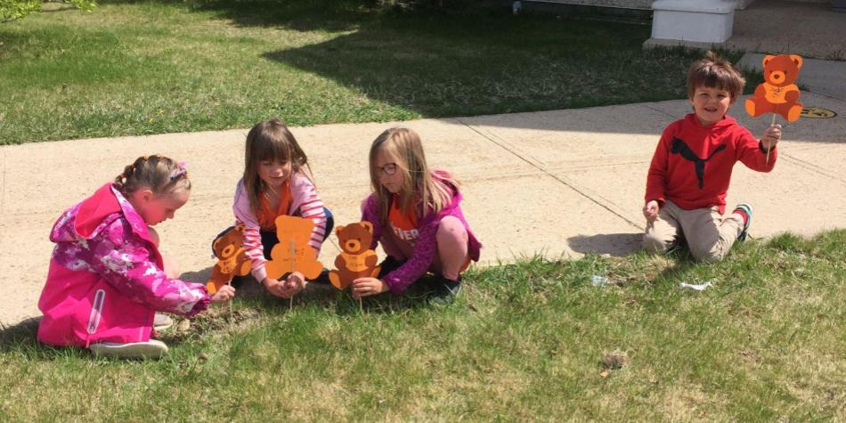 Grade 1 Students placing their Teddy Bears in memory of Kamloops 215